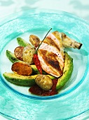 Chicken breast with roasted avocado wedges and potatoes