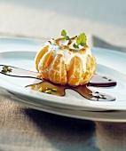 Vanilla ice cream with meringue in mandarin orange