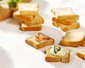 Smoked salmon & soft cheese & cucumber appetisers on tiny toast