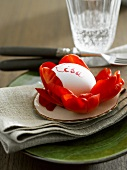 Place-setting with boiled egg & flower petals as place card
