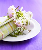 Spring place-setting with blossom wreath and eggs