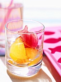 Fruity ice cubes in shape of fish