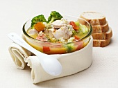 Nourishing chicken soup with vegetables, pearl barley & basil