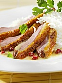 Roast duck breast with coconut sauce and rice