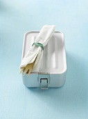 Lunch box with cutlery and napkin