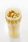 White asparagus in an opened jar