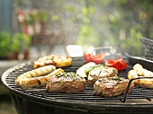Meat and sausages on a barbecue