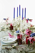Festive table with floral decorations and candelabrum