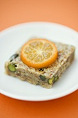 Pistachio and almond square with kumquat