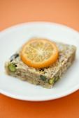 Pistachio and almond square with kumquat