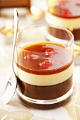 Layered chocolate & vanilla dessert with liqueur cherries