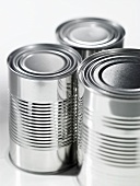 Three food tins without labels