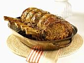 Roast prime rib in roasting dish