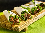 Four wraps with mince and vegetable filling