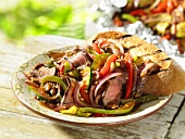 Pan-cooked meat and vegetables with garlic bread