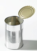An opened food tin without a label