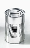 An empty food tin with a slit in the top