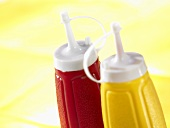 Ketchup and mustard in plastic bottles