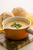 Vegetable cream soup with bread rolls