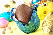 Chocolate Easter egg with opened foil