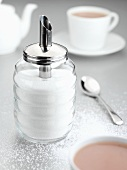 Sugar shaker with sugar and coffee