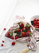 Fresh berries in a tea towel