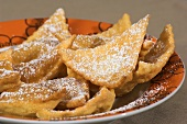 Fried pastries with icing sugar
