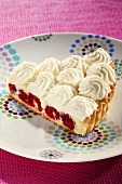 A piece of lemon and raspberry pie