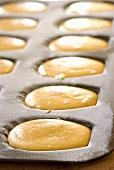 Unbaked lemon madeleines in the baking tin