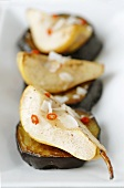Savoury pears with coconut on fried aubergine slices