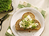 A slice of sunflower bread with cottage cheese and cress
