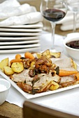 Knuckle of pork with potatoes, carrots and apple sauce