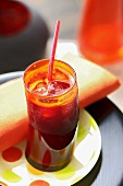 Beetroot and apple juice with ice cubes