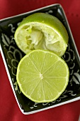 Halved lime, one half squeezed