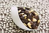 Chocolate-coated nuts