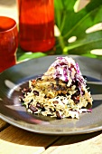Grilled chicken on rice and beans with red cabbage salad