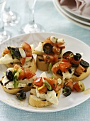 Halloumi cheese & tomato salad on grilled baguette slices