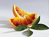 Two wedges of blood orange