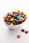 Coloured chocolate beans in a small bowl