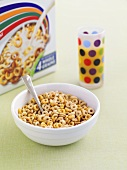 Cereal in a dish with packet in background