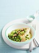 Roast chicken breast with peas on polenta