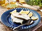 Poached cod steaks with lemon
