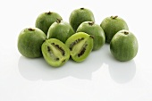 Baby kiwi fruits, whole and halved