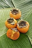 Sharon fruit, three whole and one half