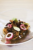 Pickled fried herrings with onions and spices