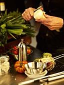 Peeling a garlic bulb