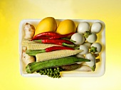 Thai vegetable mix in a plastic tray