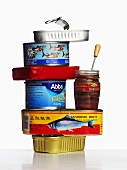 Various types of fish in tins and jar