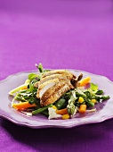 Spicy chicken breast on mixed vegetables