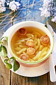 Clear broth with noodles and croutons
